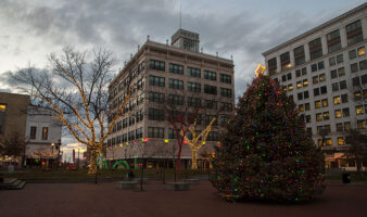 park central square decorated with christmas lights at dusk